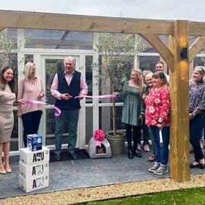 Councillor John Griffiths MBE cuts ribbon Longcroft Bury St Edmunds Grand Opening